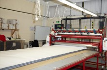 Fabric is layed out using fully automatic fabric spreading system.